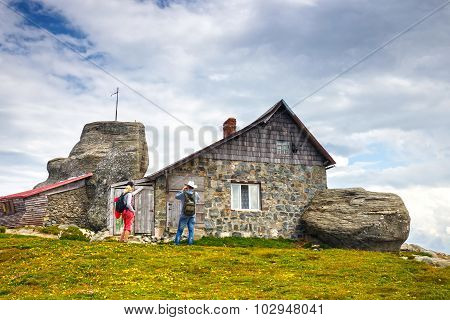 Unidentified tourists visit mountain shelter in Bucegi Mountains