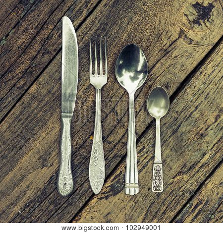 Knife, Fork, And Two Spoons
