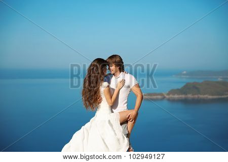 Bride And Groom Outdoor Portrait. Couple Having Passion Over Blue Sky Background. Enjoyment. Holiday