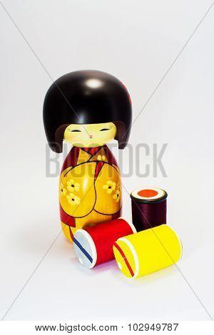 Wooden doll japan and Spool Bobbin