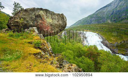 Landscape with Giant Tall Waterfall in the Valley of waterfalls