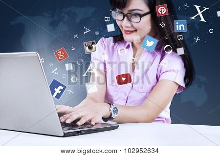 Young Businesswoman Using Social Network With Laptop