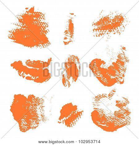 Set Of Textured Dry Brush Strokes Of Orange Paint On White Background