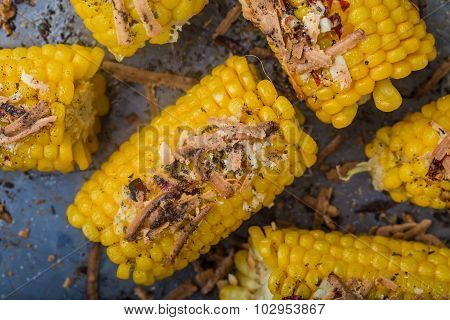 Roasted Sweet Corn On The Cob On Metal Background