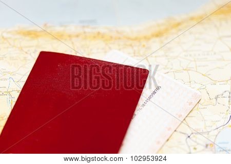 Passport, boarding pass and map