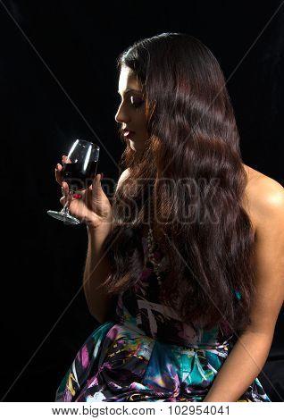 Brunette Drinking Red Wine