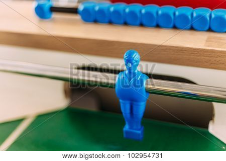 Table football game with blue player. Blue Foosball Player