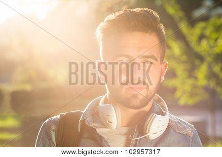 Hipster student man in earphones