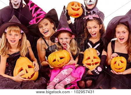 Halloween party with group children holding carving pumpkin