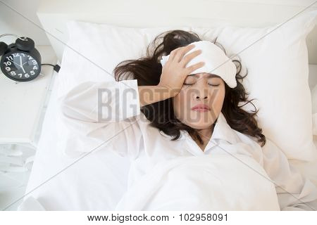 Sick Young Asian Woman Lying On Bed