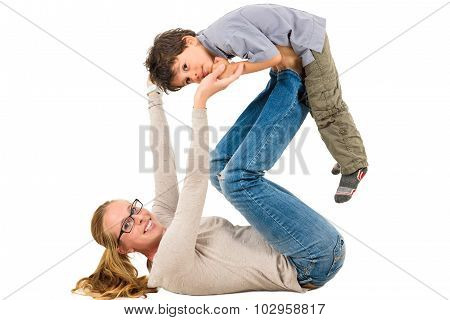 Mother And Son Are Exercising Together.