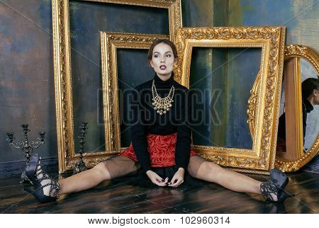 beauty rich brunette woman in luxury interior near empty frames, vintage elegance close up