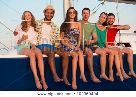 Happy young people sailing on the yacht.