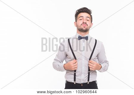Hipster man touching his braces in studio