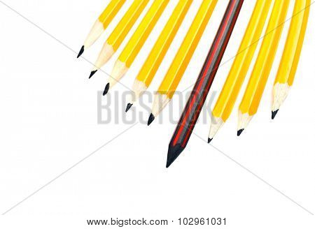 pencil standing out from a bunch of crowd pencils, leadership concept