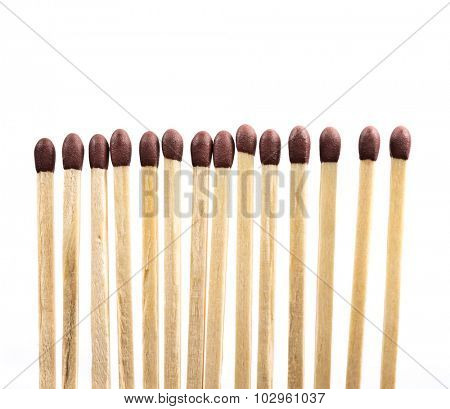 Line of matches isolated on white