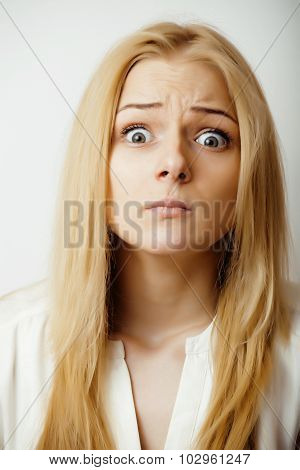 young blond woman emotional in studio isolated