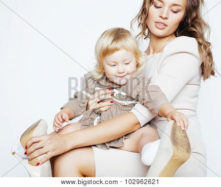 pretty real fashion mother with cute blond little daughter