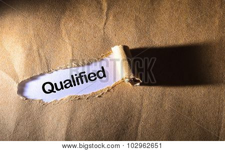 Torn Paper With Word Qualified