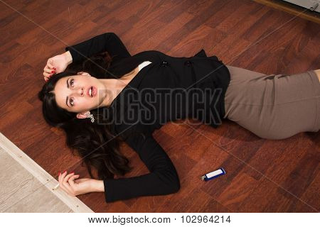 Lifeless Businesswoman In A Office Lying On The Floor