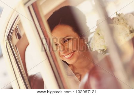 Gorgeous bride posing in the car on wedding day