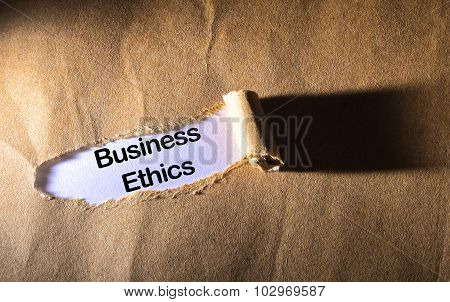 Torn Paper With Word Business Ethics