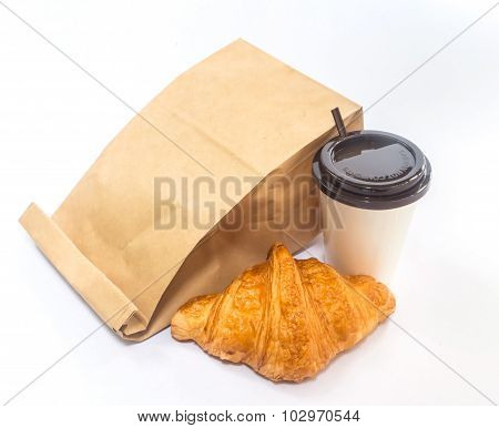 Coffee And Croissant With Paper Bag Isolated