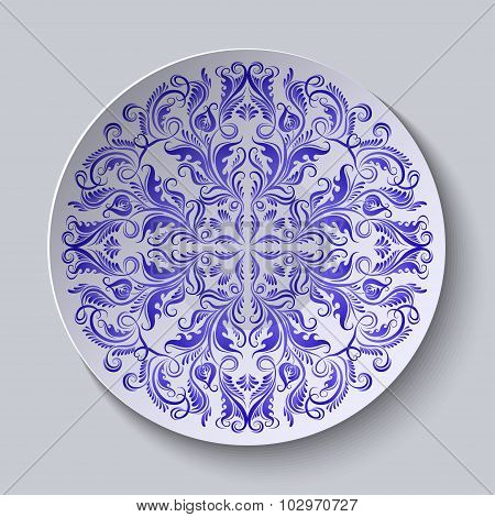 Circular plate with blue ethnic ornament.