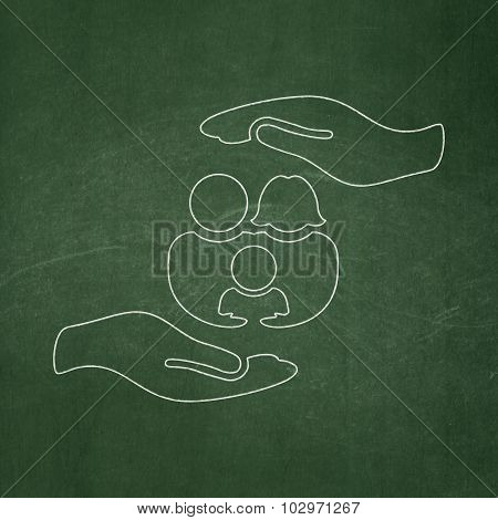 Insurance concept: Family And Palm on chalkboard background
