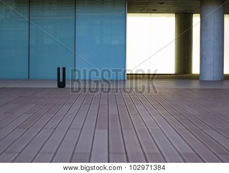 Wood floor with turquoise windows at the background