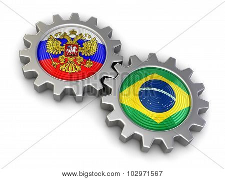 Russian and Brazilian flags on a gears (clipping path included)