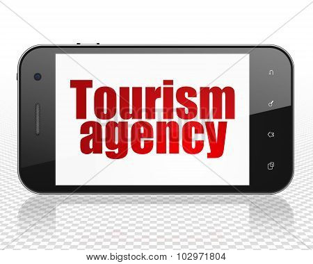 Travel concept: Smartphone with Tourism Agency on display