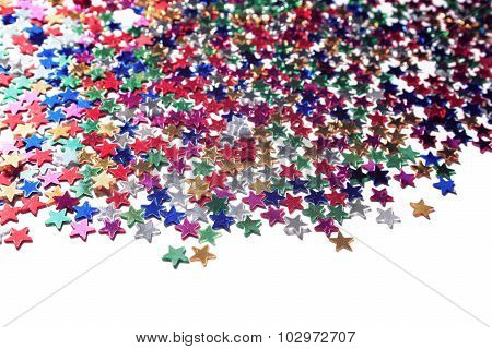 Scattered Glittering Stars Confetti. Close Up.