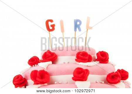Baby born cake with candles in pink isolated over white background