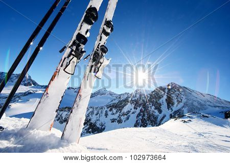 Ski equipment in high mountains in snow at winter