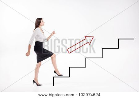 Young businesswoman walking up on stairs