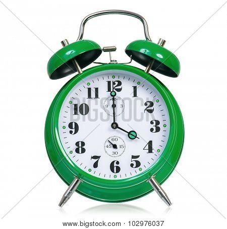 Big green alarm clock, isolated on white