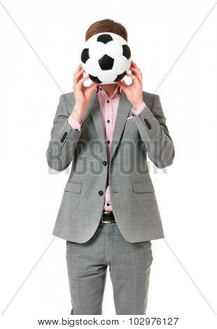 Successful young businessman in suit with soccer ball, isolated on white background