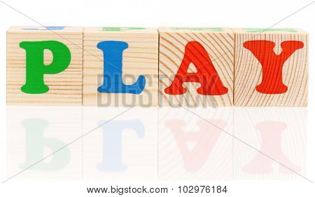Wooden blocks arranged in the word PLAY - isolated on white background
