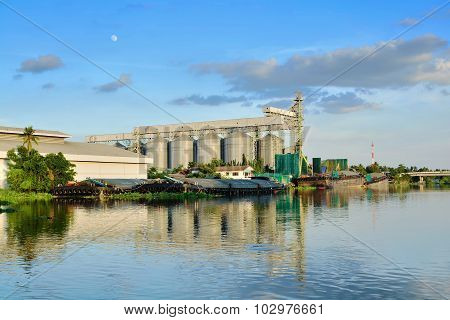 Warehouse Silo Beside The Dock And River