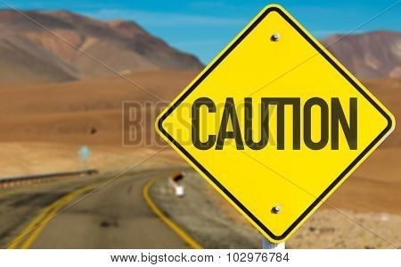 Caution sign on desert road