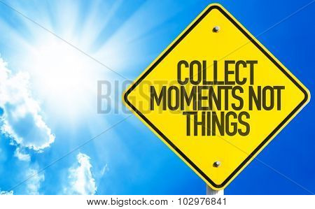Collect Moments Not Things sign with sky background
