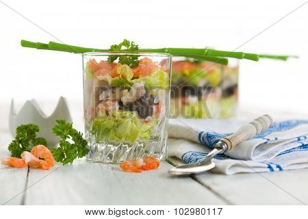 Seafood verrines with smoked salmon, shrimps, eel and salad
