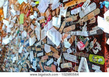 VERONA, ITALY - SEPTEMBER 2014 : Shallow DOF of a wall full of names and love declaration at Juliet's house in Verona, Italy on September 13, 2014. Photo focus on the right side