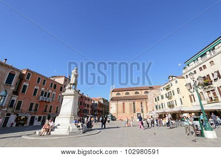 VENICE, ITALY - SEPTEMBER 2014 : People at Statue of Nicolo Tommaseo monument in Venice, Italy on September 14, 2014. Nicolo Tommaseo was a linguist, journalist, essayist, and Italian irredentism