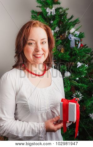 Beautiful woman holding gift box
