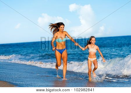 Young Women Having Fun Along Beach.