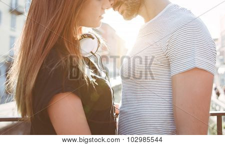 Young Couple Kissing On A Bridge In Milan