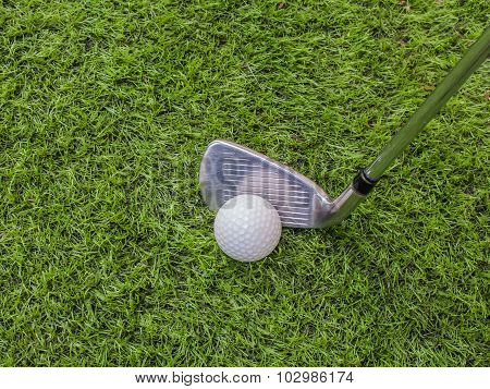 Golf Club And Ball On The Artificial Turf