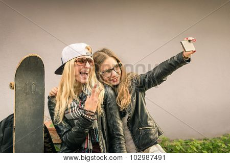 Hipster Girlfriends Taking A Selfie In Urban City Context - Concept Of Friendship And Fun
